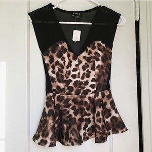BEBE top with tags